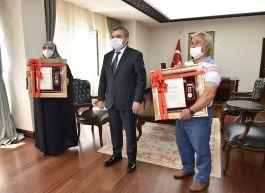 İki Şehit ailesine Devlet Övünç Madalyası ve beratı verildi